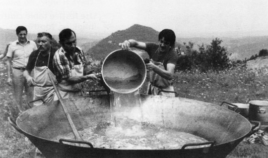 Conrad Adillon (1st from right) and his father, Miquel (3rd from right) prepare a paellafor 250 people. C1978 in the Pyrenees Mountains, Spain.